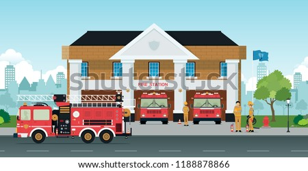 Staff and fire trucks are in front of the station.