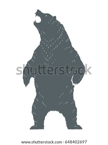 standing and roaring bear