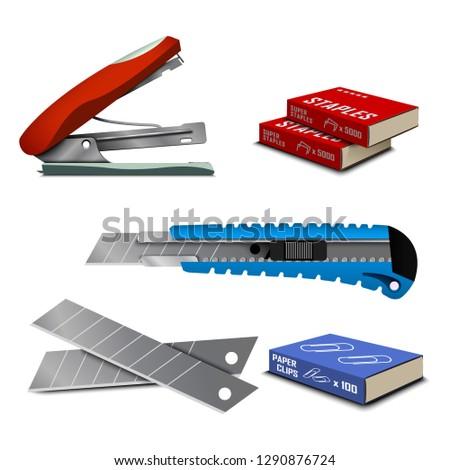 Stapler and stationery knife.  Standard staples for stapler. Office equipment. Paper clip. Clips in the box. Plastic office knife for the paper.