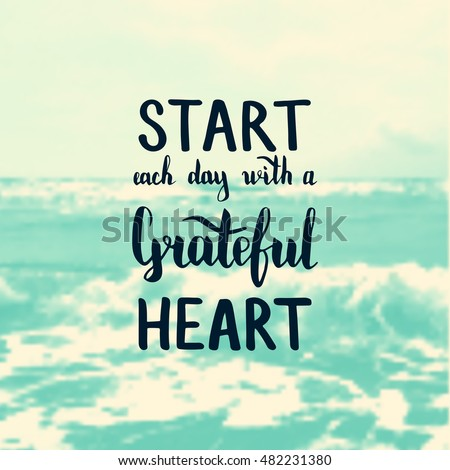 Start each day with a grateful heart. Illustration with hand-lettering inspiration and motivation quote. Text on sea photo blur background.