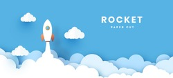 Start up business concept. rocket flying on the air,paper art and digital craft style. With shine and