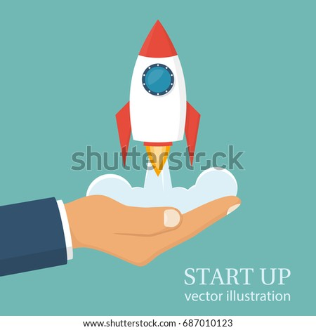 Start up concept. Businessman holds a flying rocket in hand, symbol of start of project's launch. Vector illustration cartoon flat design. Isolated on white background. Business metaphor. Photo stock ©