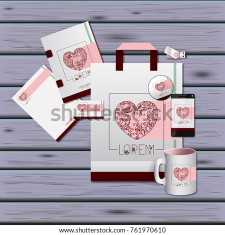 stationary templates of heart design of business stationery over violet wooden background #761970610