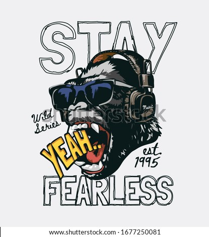 stay fearless slogan with gorilla in sunglasses wearing headphone illustration