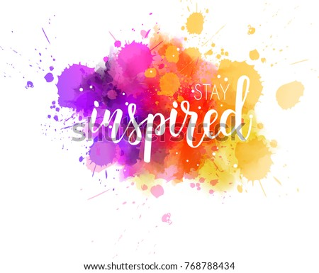 Stay inspired hand lettering phrase on watercolor imitation color splash.  Modern calligraphy inspirational quote. Vector illustration.