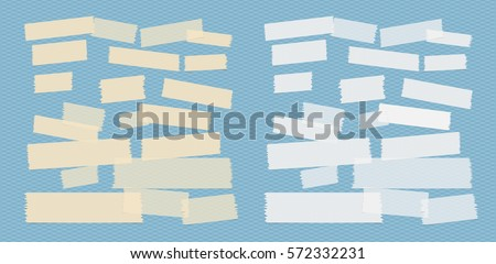 Sticky adhesive paper strips, masking tape, stuck on blue squared background