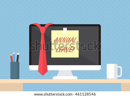 Sticky note with word annual leave on monitor, vacation and holiday concept
