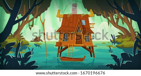 stilt house in swamp with boat