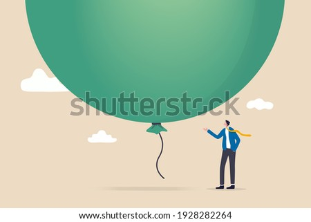 Stock market, crypto currency bitcoin bubble, risk of speculation investment, big debt balloon ready to burst concept, fearful businessman investor standing under huge big air balloon bubble.