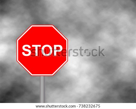 stop sign road in grey sky