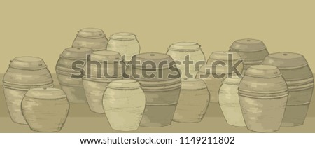 Storage of kimchi and sauces in South Korea. Traditional Korean barrels. Clay pots for storage. Culture of South Korea. Korean antique dishes.