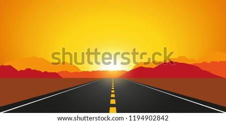 straight asphalt road in autumn