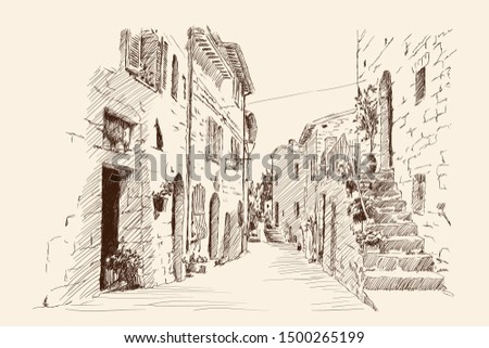 Street of the ancient city with stone houses and a stairs.