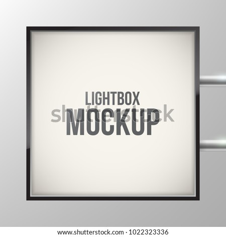 Street sign hanging mounted on the wall. Square illuminated lightbox with empty space for design. Restaurant, hotel, night club logo presentation. Cinema or theater light box frame for ads.