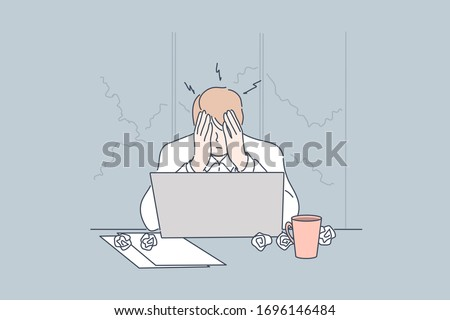 Stress, depression, frustration, overworking, fatigue business concept. Young frustrated depressed businessman, boy clerk manager sits on workplace at office. Mental work stress. Overworking, headache