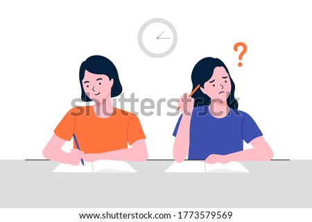 Stressed school student filling out answers to exam test answer sheet with pencil sitting at a classroom desk. Not knowing answers. the smart woman taking a test, preparing for exams at University. Photo stock ©