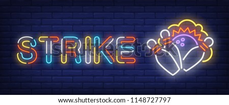 Strike neon style banner. Text and bowling ball with bowls on brick background. Night bright advertisement. Can be used for signs, posters, billboards