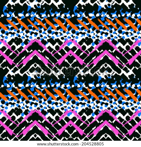 Striped hand painted vector seamless pattern with ethnic and tribal motifs zigzag lines and brushstrokes in multiple bright colors for summer fall fashion