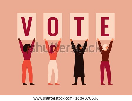 Strong girls different nationalities and cultures stand together and raise up posters with word VOTE. Women activists are calling for votes. Voting and Election concept. Pre-election campaign.