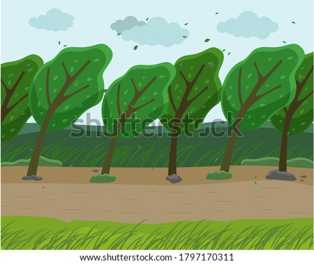 Strong wind and heavy fall of the leaves in the forest. Autumn wind blowing in the park. Green trees bend to the ground from strong winds, the sky is filled with clouds, Empty park in bad weather Stockfoto ©