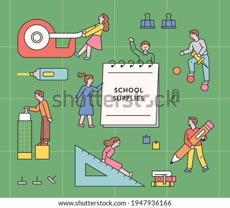 Student characters using huge school supplies. flat design style minimal vector illustration.