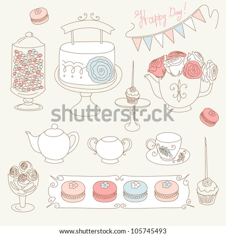 Stylish Birthday party set with bunting cup cakes roses birthday cake tea candles and macaroons