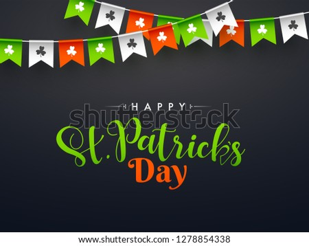 Stylish calligraphy of Happy St. Patrick's Day on black background decorated with bunting flags. Can be used as banner or greeting card design.
