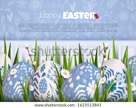 Stylish Easter background with blue and white eggs with floral pattern in the grass.