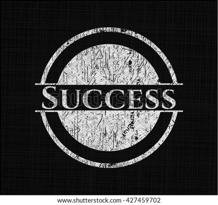 Success written on a blackboard
