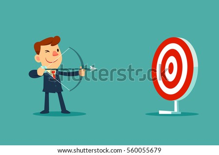 successful businessman aiming...