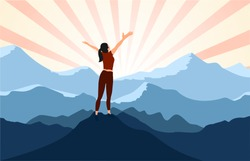 successful woman hiker enjoy  the view with arms open on cliff edge top of mountain and sunshine background.