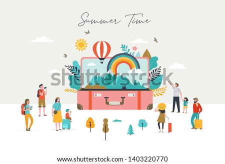 Summer scene, group of people, family and friends having fun against the huge open suitcase with travel scene, mountains, nature, rainbow and air balloon