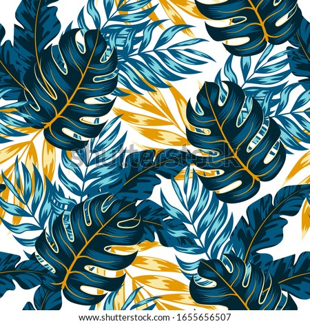 Summer seamless tropical pattern with bright leaves and plants on a white background. Modern abstract design for fabric, paper, interior decor. Summer colorful hawaiian.
