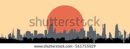 sun over city silhouette