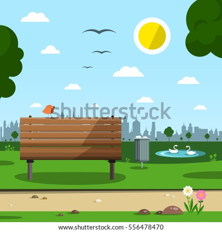 sunny day in park with town