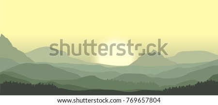 sunrise over misty mountain