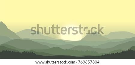 sunrise over misty mountain