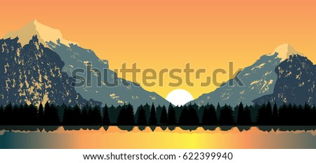 sunset behind mountain peaks