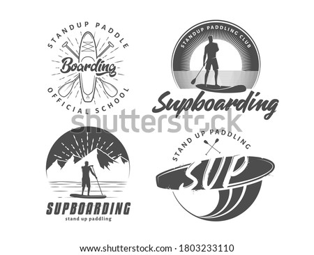 SUP boarding logos. Stand up paddling badges. Set of vector emblems with SUP boards, surfers and equipment Stock photo ©