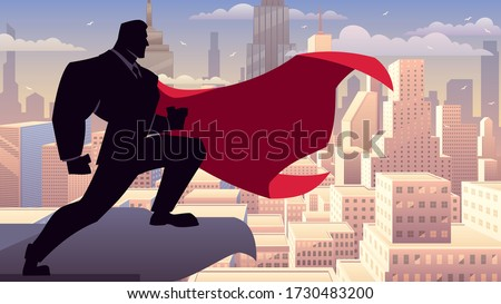 Super businessman watching over the city from the roof of a tall building.