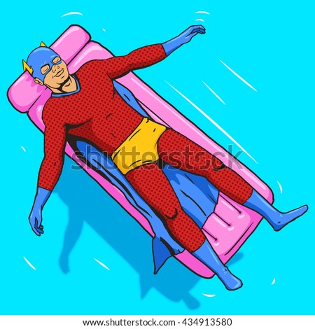 superhero lying on air mattress ...