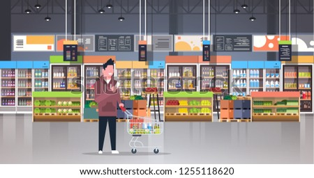 supermarket man customer checking shopping list carrying trolley cart male shopper buying products grocery market interior flat horizontal