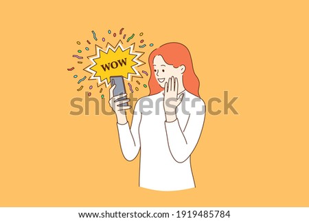 Surprise, shocking news, internet concept. Young smiling female blogger reading shocking news in message on mobile phone using network connection on smartphone with emotional wow word