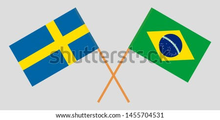 Sweden and Brazil. Crossed Swedish and Brazilian flags