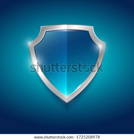 Symbol of protection, guard. Blue glossy shield with silver trim. Heraldic element. Foto stock ©