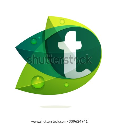 t letter with green leaves and
