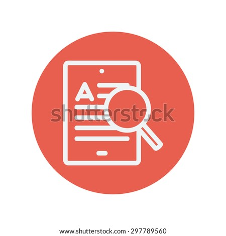 tablet and magnifying glass