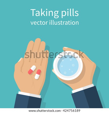 taking the pills man holds in