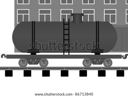 Tank car on a moving background of the building on the tracks.