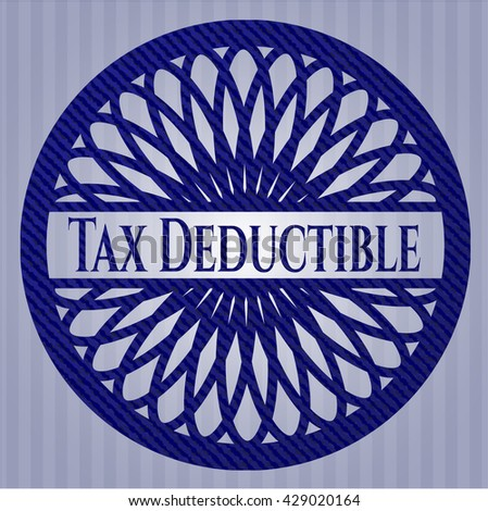 Tax Deductible emblem with jean background